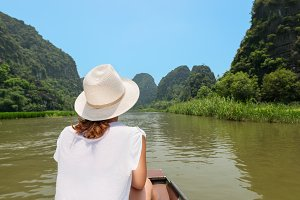 Woman traveling by boat on river