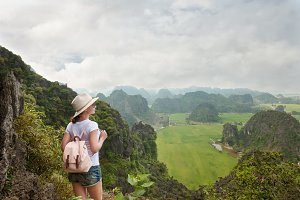 woman with backpack enjoying view