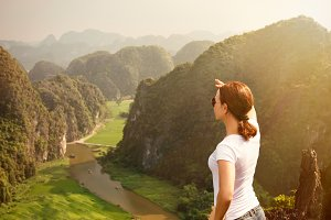 woman tourist looking far away