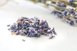 Dried lavender flowers over a white