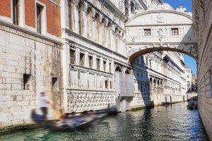 Gondola floats on a canal, Venice