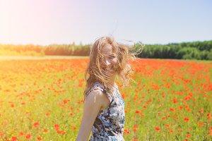 Beautiful girl on summer field