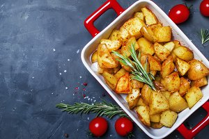 Baked potatoes with spices and rosem