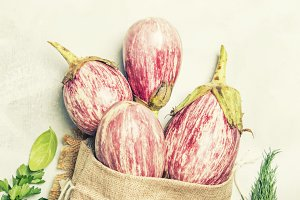 Fresh purple striped eggplants in a