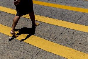 Woman crossing road Hong Kong