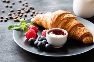 Tasty croissant, berries and jam