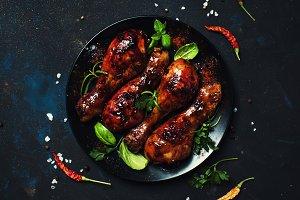 Baked chicken legs in spicy glaze wi