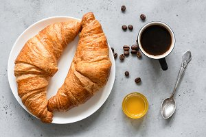 Croissants, coffee and honey
