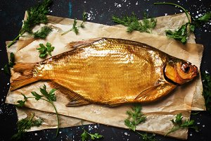Smoked Tsimlyansky bream on dark bac