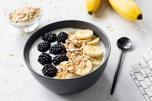 Breakfast smoothie bowl with banana