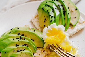 toast with fresh avocado and egg on