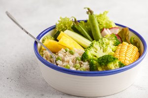 Vegan bowl with rice and vegetable