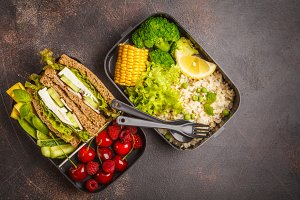meal prep containers with sandwiches