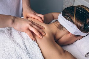 Woman receiving relaxing back massag