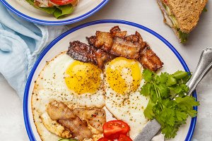 Fried eggs with bacon and sandwich