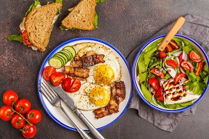 Vegetable salad , sandwich and eggs