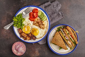 Fried eggs with bacon and sandwiches