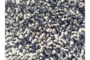 Iron in briquettes piled high in the