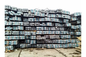 Metal square rods. Warehouse of