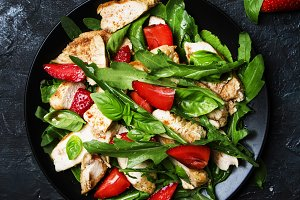 Delicious salad with arugula, strawb