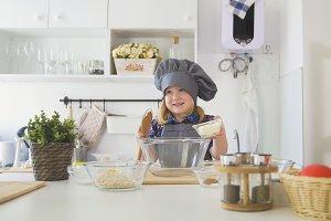 Little girl baker puts batter to the