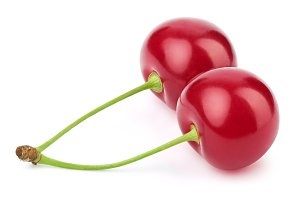 Two fresh cherries isolated on white
