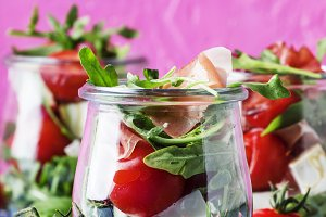 Salad with arugula, cheese, cherry t