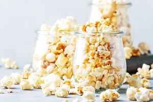 Sweet popcorn, junk food, gray backg