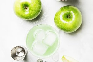 Alcoholic cocktail with green apple