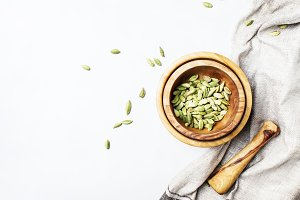 Dry whole cardamom in wooden bowl, g