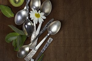 vintage spoons on wooden background