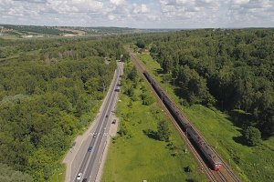 Highway with cars and a railway with