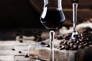 Coffee liqueur, vintage wooden backg