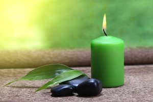 candle light, leaf and stones
