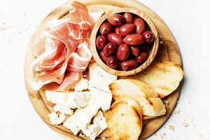 Board with appetizers, crostini, pro