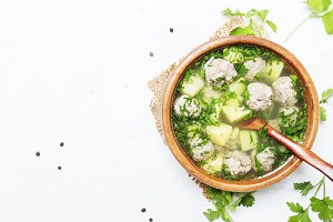 Soup with chicken meatballs, white b
