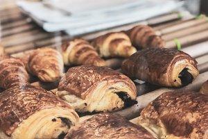 Freshly baked croissants on wooden