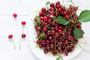 Spilled red cherries. Cherries in a