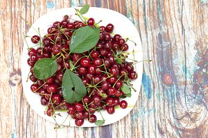 Red cherry in a plate. Fresh cherry.