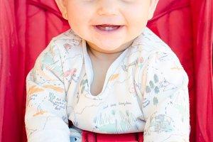 Smiling baby sitting.