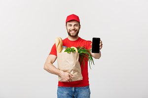 Delivery man holding paper bag with