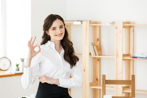 Young business woman showing ok sign