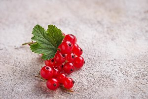 Ripe red currant berries and leaves