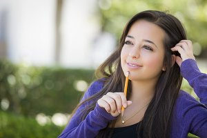 Pensive Mixed Race Female Student wi