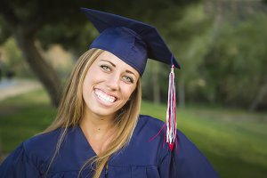 Young Woman Wearing Cap and Gown Out