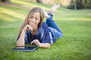 Smiling Young Woman Using Computer T