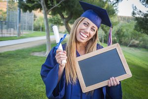 Woman Holding Diploma and Blank Chal