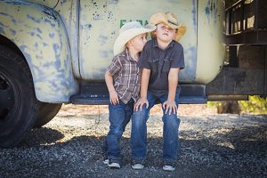Two Young Boys Wearing Cowboy Hats L