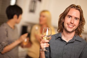 Smiling Young Man with Glass of Wine