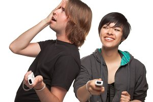 Fun Diverse Couple Playing Video Gam
